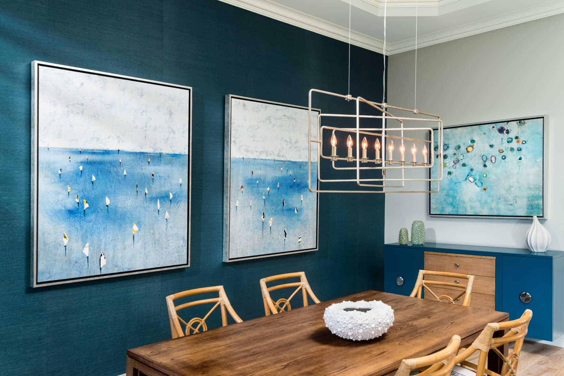 Dining room with decorative art and contemporary chandelier