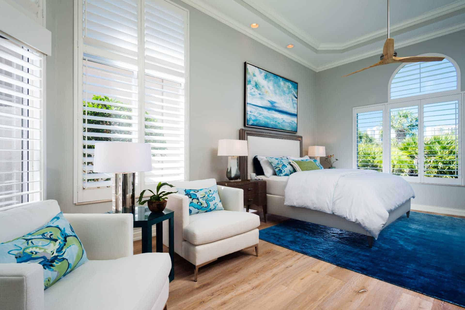 Master bedroom with lounge seating and an open view of the outdoors